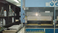 Perchloric acid fume hood and support bench work. Fume hoods have washdown scrubber systems that remove exhuast fumes and capture them. The optional recirculation systems reduce water consumption and allow for neutralization and treatment prior to dicharge.
